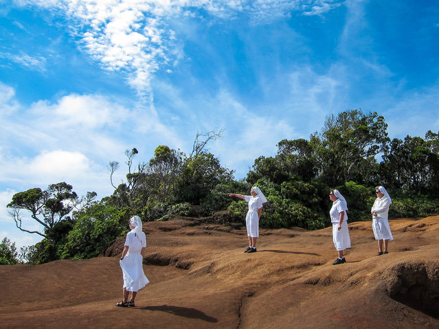 """""""While exploring Kauai in the Hawaiian archipelago we kept crossing paths with a group of nuns who were also visiting. For me, the scene has a surreal/biblical feel"""". (Photo by Stephane Hebet/The Guardian)"""