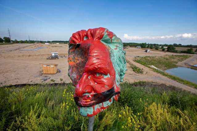 The head from a statue of Egerton Ryerson, considered one of the architects of Canada's residential school system, is seen after its removal, at 1492 Land Back Lane reclamation camp set up by Six Nations of the Grand River in Caledonia, Ontario, Canada on June 9, 2021. Protesters in Toronto tore down the statue of Ryerson, an educator and Methodist minister who was one of the architects of a system that had aimed to assimilate indigenous children so that they would lose their ties to their families and cultures. (Photo by Carlos Osorio/Reuters)