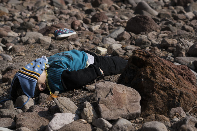 The lifeless body of a migrant boy lies on the beach near the Aegean town of Ayvacik, Canakkale, Turkey, Saturday, January 30, 2016. (Photo by Halit Onur Sandal/AP Photo)