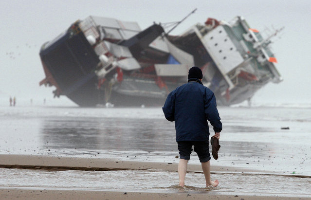 "A man walks towards the cargo ferry ""Riverdance"" which remains beached off the North Shore of Blackpool, northern England, February 5, 2008. (Photo by Phil Noble/Reuters)"