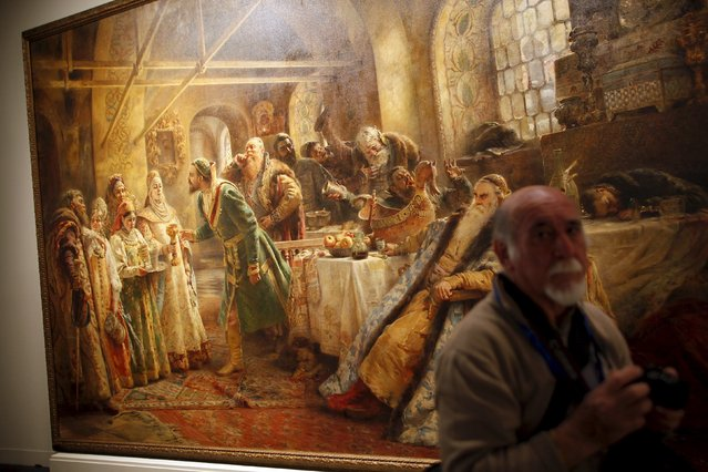 """A man stands next to """"Kissing ritual"""" by Russian-born artist Konstantin Makovsky during an international press tour of the Malaga branch of the State Museum of Russian Art of St Petersburg, a day before its inauguration in Malaga, southern Spain March 24, 2015. (Photo by Jon Nazca/Reuters)"""