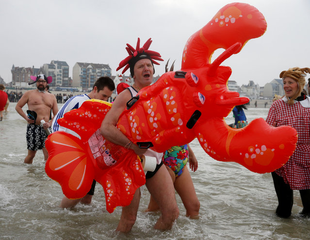 People wearing costumes participate in a traditional New Year's Day swim in Dunkirk, France January 1, 2017. (Photo by Pascal Rossignol/Reuters)