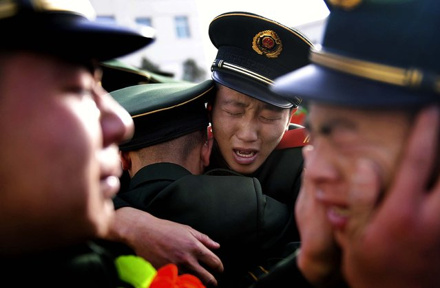 Paramilitary policemen cry as they see off veterans during a farewell ceremony in Taiyuan, China, on November 24, 2013. (Photo by Reuters)