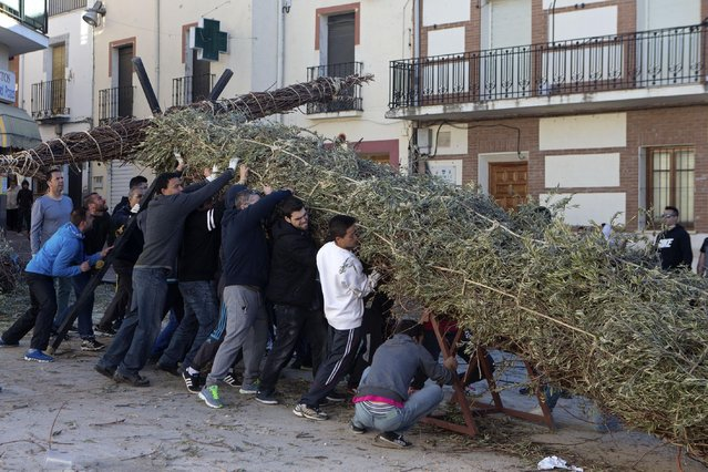 Youths, with the help of older men from the village help erect a cross in Tielmes, Spain on Easter Sunday  Sunday, April 5, 2015 marking the end of Holy week. (Photo by Paul White/AP Photo)