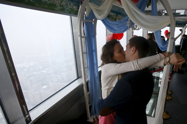A couple kisses at an observation platform of the Ostankino television tower ahead of Valentine's Day in Moscow, Russia, February 13, 2016. (Photo by Maxim Shemetov/Reuters)