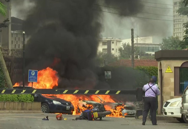 This frame taken from video shows a scene of an explosion in Kenya's capital, Nairobi, Tuesday January 15, 2019. Gunfire and explosions were reported near an upscale hotel complex. (Photo by Josphat Kasire/AP Photo)