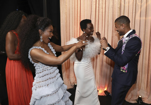 """Angela Bassett, from left, Danai Gurira and Michael B. Jordan celebrate """"Black Panther"""" winning the award for outstanding performance by a cast in a motion picture at the 25th annual Screen Actors Guild Awards at the Shrine Auditorium & Expo Hall on Sunday, January 27, 2019, in Los Angeles. (Photo by Matt Sayles/Invision/AP Photo)"""