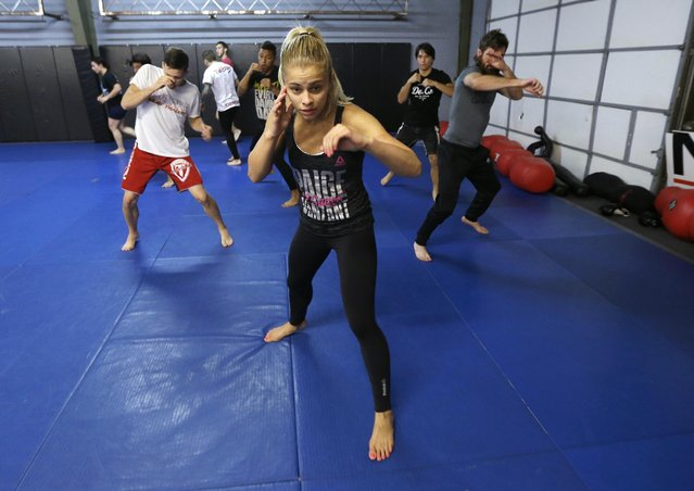 In this Monday, April 13, 2015, photo, mixed martial arts fighter Paige VanZant does some shadow boxing as she works out in preparation for an Ultimate Fighting Championship bout, at Ultimate Fitness in Sacramento, Calif. VanZant, 21, is scheduled to fight Felice Herrig in an Ultimate Fighting Championship strawweight match in New Jersey on Saturday. (Photo by Rich Pedroncelli/AP Photo)