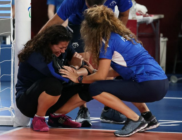 Lihi Ben David of Israel is consoled after her team lost the women's goalball quarterfinal match to Japan at Makuhari Messe Hall C in Chiba, Japan on September 1, 2021. (Photo by Ivan Alvarado/Reuters)
