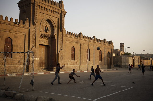Children, who live in the Cairo Necropolis, play soccer next to ancient tombs in Cairo, Egypt, September 13, 2015. (Photo by Asmaa Waguih/Reuters)