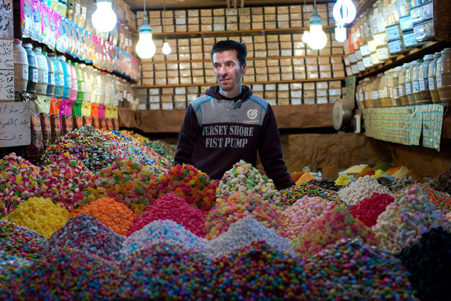 A Syrian shopkeeper waits for customers at the popular Souk Tawil old market in Damascus, Syria, Wednesday, February 24, 2016. (Photo by Hassan Ammar/AP Photo)