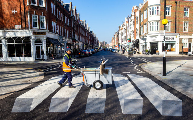 Westminster council has installed a 3D zebra crossing on St John's Wood high street in an attempt to slow drivers down and improve pedestrian safety in London, England on February 24, 2019. (Photo by Tommy London/Alamy Live News)