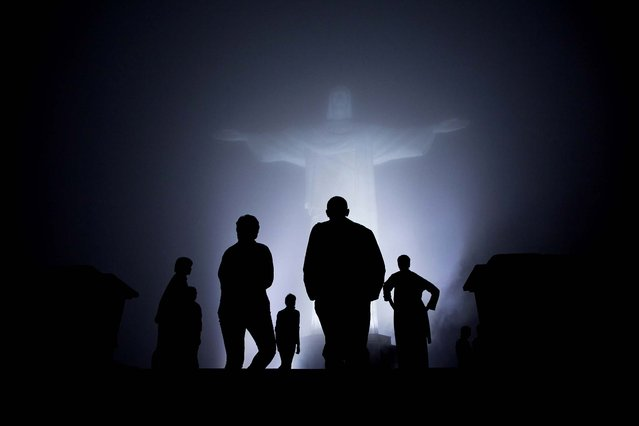 President Barack Obama, First Lady Michelle Obama, and daughters Sasha and Malia, tour the Christ the Redeemer statue on March 19, 2011. (Photo by Pete Souza/The White House via Getty Images)