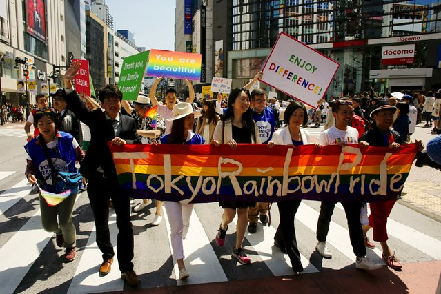 Participants hold a banner as they march during the Tokyo Rainbow Pride parade in Tokyo April 26, 2015. (Photo by Thomas Peter/Reuters)