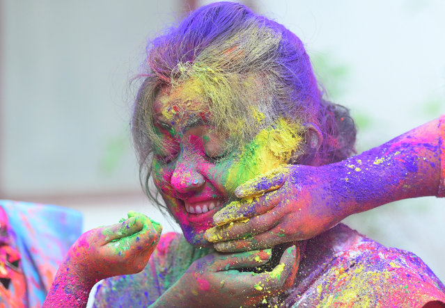 Girls seen playing with colors on the festive day of Holi on March 20, 2019 in Agartala, Tripura, India. (Photo by Abhisek Saha/Barcroft Images via Getty Images)