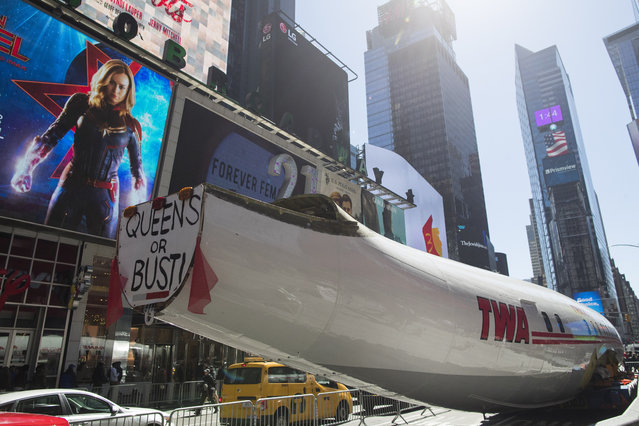 """A Lockheed Constellation L-1649A Starliner, known as the """"Connie"""", is parked in New York's Times Square during a promotional event, Saturday, March 23, 2019, in New York. The vintage commercial airplane will serve as the cocktail lounge outside the TWA Hotel at JFK airport. (Photo by Mary Altaffer/AP Photo)"""