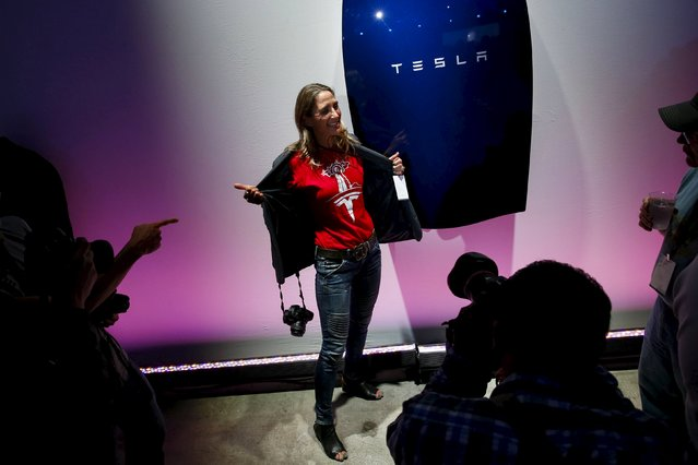 Attendees take pictures of the new Tesla Energy Powerwall Home Battery during an event at Tesla Motors in Hawthorne, California April 30, 2015. Tesla Motors Inc unveiled Tesla Energy – a suite of batteries for homes, businesses and utilities – a highly-anticipated plan to expand its business beyond electric vehicles. (Photo by Patrick T. Fallon/Reuters)