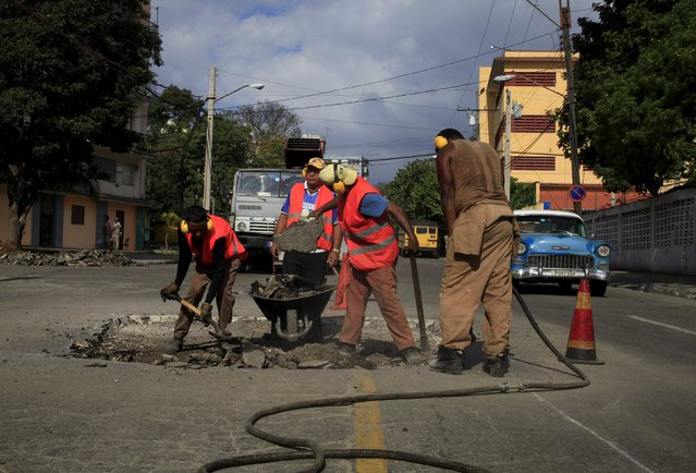 Men work on a street near Cuban baseball national stadium February 28, 2016. (Photo by Enrique de la Osa/Reuters)