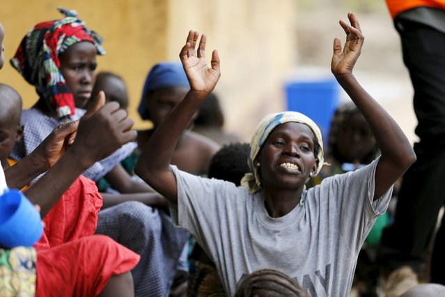 A woman rescued from Boko Haram in Sambisa forest is seen celebrating her freedom at Malkohi camp for Internally Displaced People in Yola, Adamawa State, Nigeria May 3, 2015. (Photo by Afolabi Sotunde/Reuters)