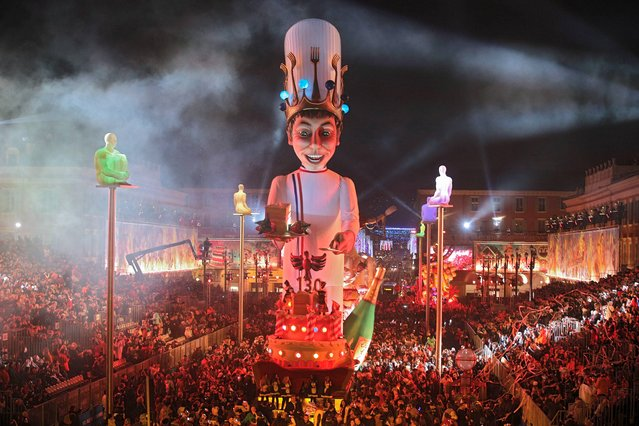 """The King float parades during the Nice Carnival on February 15, 2014 in Nice, southeastern France. The Carnival, starting from February 14 until March 4, 2014, celebrates the """"King of Gastronomy"""". (Photo by Lionel Cironneau/AP Photo)"""