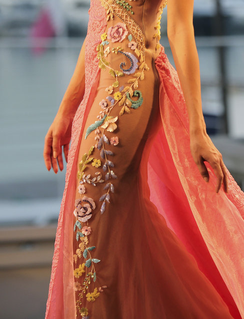 A model displays a creation by the Emirati designer Mona al-Mansouri of her Spring-Summer 2015 fashion show during the summer fashion week at Saint George Yacht Club in Beirut, Lebanon, Tuesday, May 19, 2015. (Photo by Hussein Malla/AP Photo)
