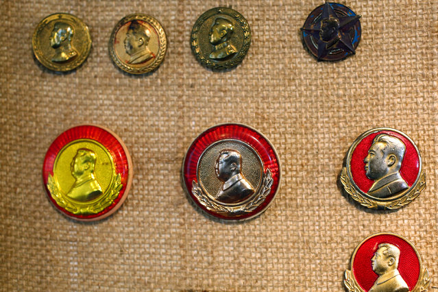Older badges featuring former North Korean leader Kim Il Sung are displayed in the glass case of Thomas Hui at his apartment in Hong Kong, China April 11, 2016. (Photo by Bobby Yip/Reuters)