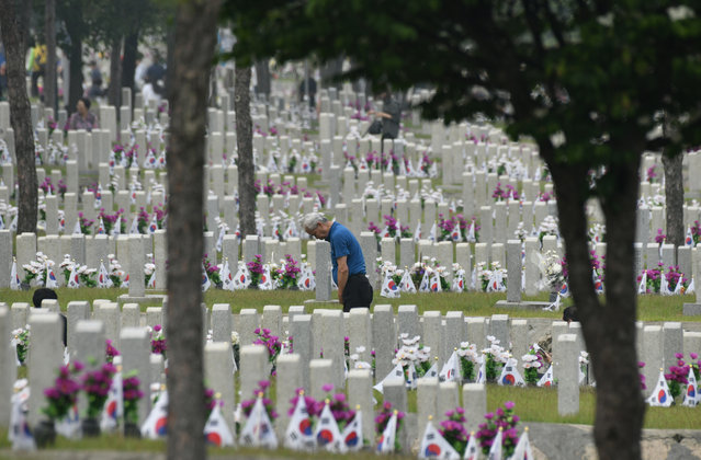 A South Korean man visits the grave of his relative killed in the 1950-53 Korean War, at the National Cemetery in Seoul on June 6, 2019 on the Korean Memorial Day. South Korea marked the 64th anniversary of Memorial Day, remembering those killed in the 1950-53 Korean War. (Photo by Jung Yeon-je/AFP Photo)