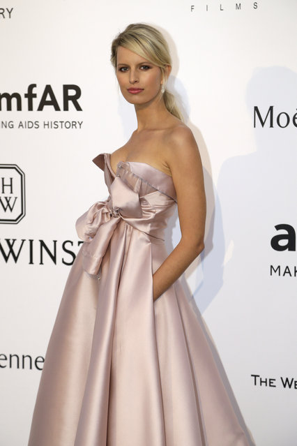 Model Karolina Kurkova poses for photographers upon arrival for the amfAR Cinema Against AIDS benefit at the Hotel du Cap-Eden-Roc, during the 68th Cannes international film festival, Cap d'Antibes, southern France, Thursday, May 21, 2015. (Photo by Thibault Camus/AP Photo)