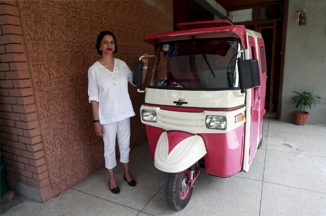 Zar Aslam, president of Pakistan's non-profit Environment Protection Fund, poses beside a Pink Rickshaw in Lahore April 8, 2015. Aslam, a Pakistani environmentalist, fed up with being groped and harassed by male auto-rickshaw drivers, has launched her own service exclusively for women passengers and drivers in her home city of Lahore – with just the one rickshaw on the road so far. (Photo by Mohsin Raza/Reuters)