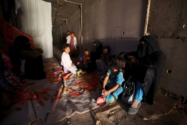 Displaced people rest in an underground water tunnel after they were forced to flee their homes due to ongoing air-strikes carried out by the Saudi-led coalition in Sanaa May 2, 2015. (Photo by Mohamed al-Sayaghi/Reuters)