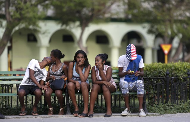Teenagers gather in a square in Havana March 24, 2016. (Photo by Enrique de la Osa/Reuters)