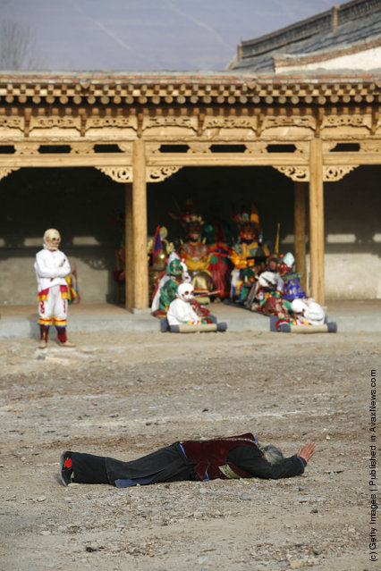 A pilgrim of Tu ethnic minority group pray