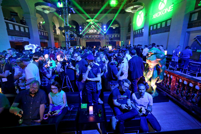 Excited gamers interact with newly announced games and experiences at the Xbox Media Showcase at E3 2015 in Los Angeles on Monday, June 15, 2015. (Photo by Casey Rodgers/Invision for Microsoft/AP Images)