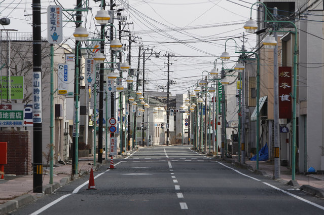 An empty shopping street is seen in Tomioka town, inside the exclusion zone of a 20km radius around the crippled Fukushima Daiichi nuclear power plant, Fukushima prefecture, January 15, 2012. (Photo by Issei Kato/Reuters)