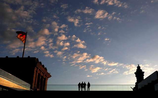 People are seen on the roof of the lower house of parliament Bundestag at the Reichstags building in Berlin, Germany, May 29, 2019. (Photo by Fabrizio Bensch/Reuters)
