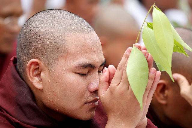 A supporter of a hard-line Buddhist monk Wirathu prays at Shwedagon Pagoda in Yangon, following the monk's arrest warrant on a charge of sedition in Yangon, Myanmar, May 30, 2019. (Photo by Ann Wang/Reuters)
