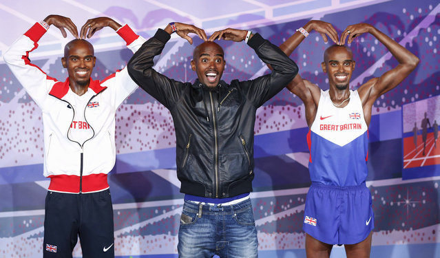 British Olympic athlete Mo Farah poses with two waxworks, one of which will be displayed in London and the other in Blackpool at Madame Tussauds, in London April 14, 2014. (Photo by Olivia Harris/Reuters)