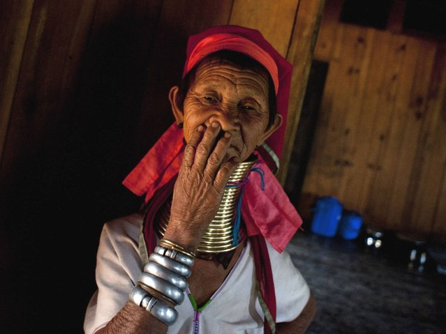The government of Burma began discouraging neck rings as it struggled to appear more modern to the developed world. Consequently, many women in Burma began breaking the tradition, though a few older women and some of the younger girls in remote villages continued to wear rings. (Photo by Ye Aung Thu/AFP Photo)