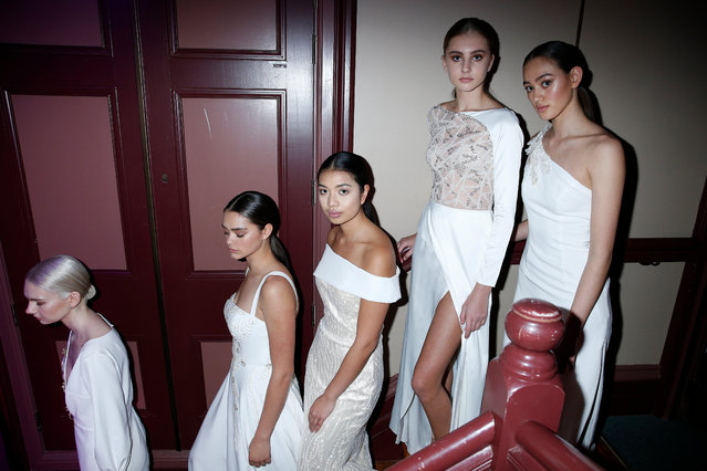 Models prepare backstage ahead of the Collections: Ivory and Stone Bridal, Mallo show during New Zealand Fashion Week 2019 at Auckland Town Hall on August 27, 2019 in Auckland, New Zealand. (Photo by Michael Ng/Getty Images)