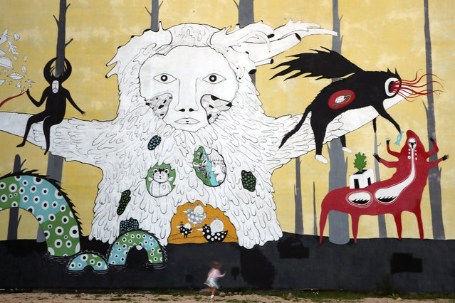 A mural in Oktyabrskaya Street in Minsk, Belarus on August 24, 2019. The Tsekh art space, bars and cafes are located at the former Energiya Iron Foundry in Oktyabrskaya Street. (Photo by Natalia Fedosenko/TASS)