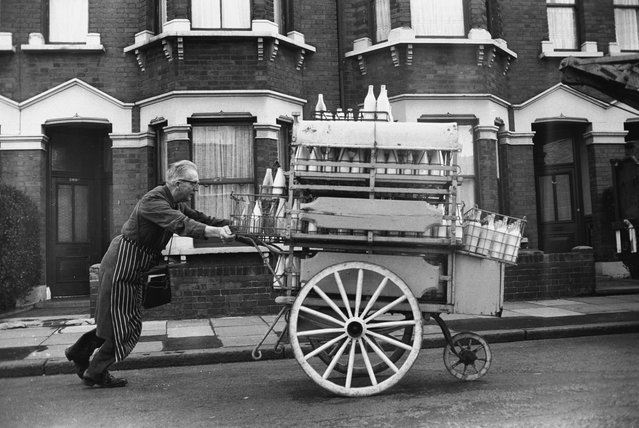 A milkman on his rounds in the East End of London, 1960s. (Photo by Steve Lewis/Getty Images)