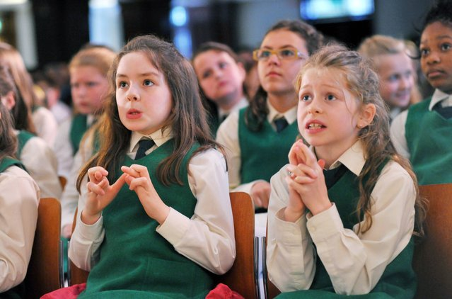 Grace Hernan (9) and Grace Campbell (9) pictured nervously await the results of the National Competition for Schools in Cork city hall, part of the Cork International Choral Festival, on April 30, 2014. Their choir was unsuccessful. (Photo by Daragh Mc Sweeney/Provision)