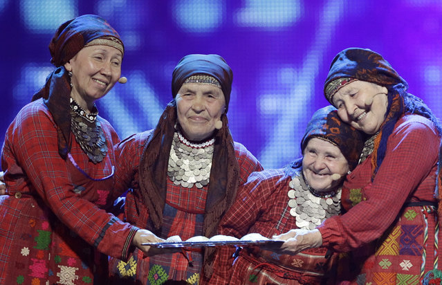 In this Friday, May 25, 2012 file photo, Russia Buranovskiye Babushki perform during a rehearsal for the final of the 2012 Eurovision Song Contest at the Baku Crystal Hall in Baku, Azerbaijan. They garnered much public affection for their cute onstage presence that included some choreographed baking in an onstage oven. (Photo by Sergey Ponomarev/AP Photo)