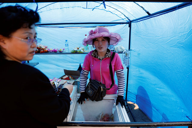 A woman sells snacks in central Pyongyang, North Korea April 16, 2017. (Photo by Damir Sagolj/Reuters)