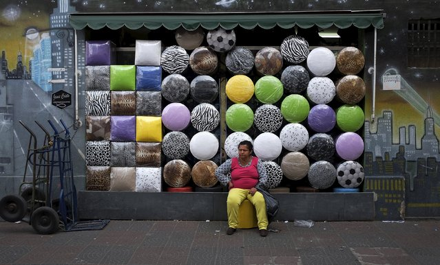 A woman sits in front of a shop selling stools after buying one in the Bras neighborhood of Sao Paulo in this August 9, 2013 file photo. Brazil is expectyed to release May retail sales data this week. (Photo by Nacho Doce/Reuters)