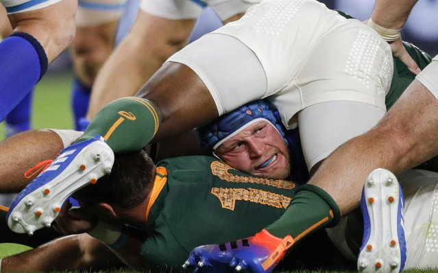 Italy's hooker Luca Bigi reacts during a ruck during the Japan 2019 Rugby World Cup Pool B match between South Africa and Italy at the Shizuoka Stadium Ecopa in Shizuoka on October 4, 2019. (Photo by Adrian Dennis/AFP Photo)