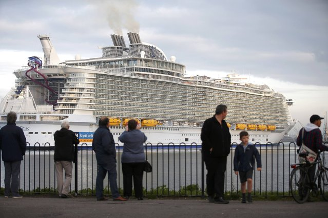 Bystanders watch the worlds largest cruise ship, the 361 metres long, Harmony of the Seas, arrives in port for its mayden voyage, in Southampton, Britain May 17, 2016. (Photo by Peter Nicholls/Reuters)