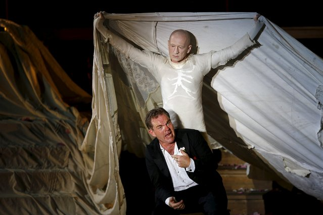 """Actors Cornelius Obonya as Jedermann (front) and Peter Lohmeyer as Tod perform on stage during a dress rehearsal of Hugo von Hofmannsthal's drama """"Jedermann"""" (Everyman) at Domplatz square in Salzburg, Austria, July 16, 2015. (Photo by Leonhard Foeger/Reuters)"""