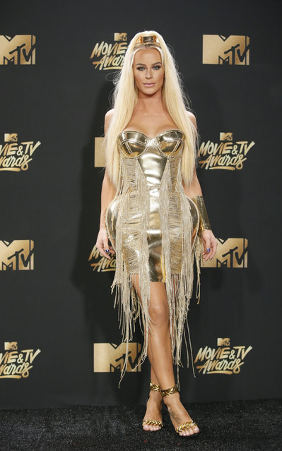 Model Gigi Gorgeous attends the 2017 MTV Movie And TV Awards at The Shrine Auditorium on May 7, 2017 in Los Angeles, California. (Photo by Danny Moloshok/Reuters)