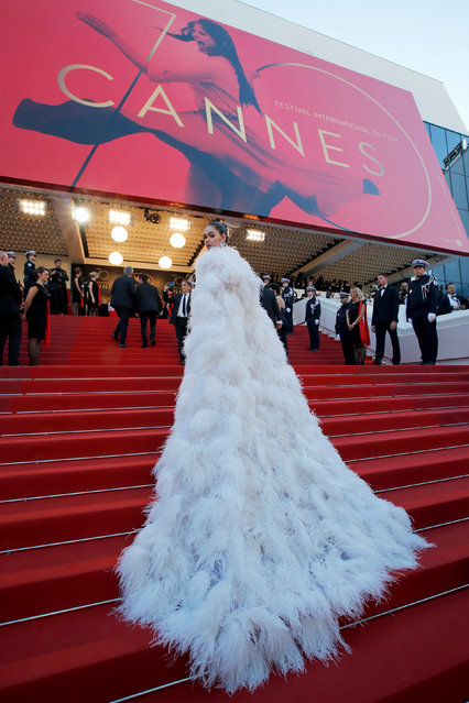 """Guest attends the """"Ismael's Ghosts (Les Fantomes d'Ismael)"""" screening and Opening Gala during the 70th annual Cannes Film Festival at Palais des Festivals on May 17, 2017 in Cannes, France. (Photo by Jean-Paul Pelissier/Reuters)"""
